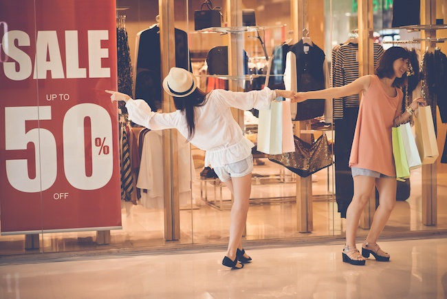 Two girls shopping sales