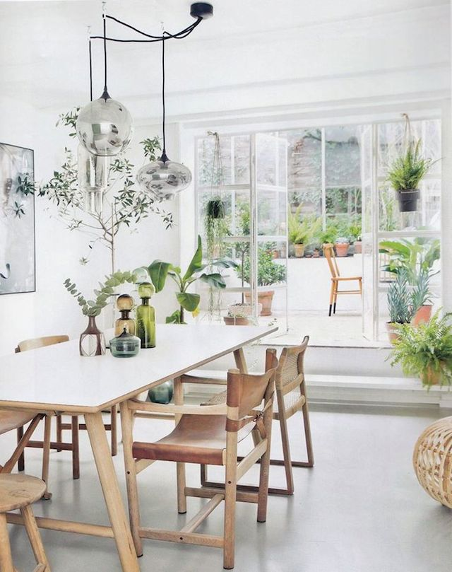 White tone dining room with greenery accents