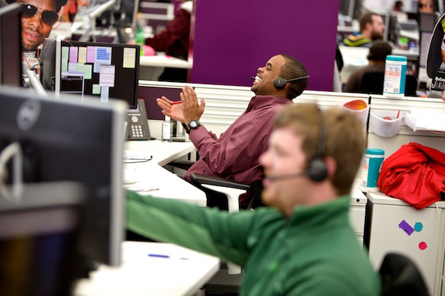 Team member laughs while on the phone
