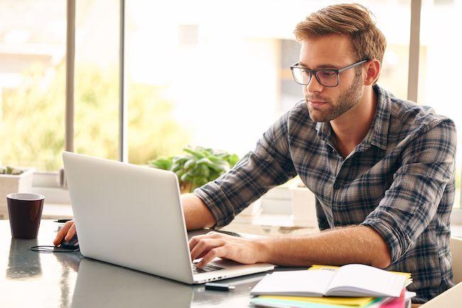 Man on laptop working.