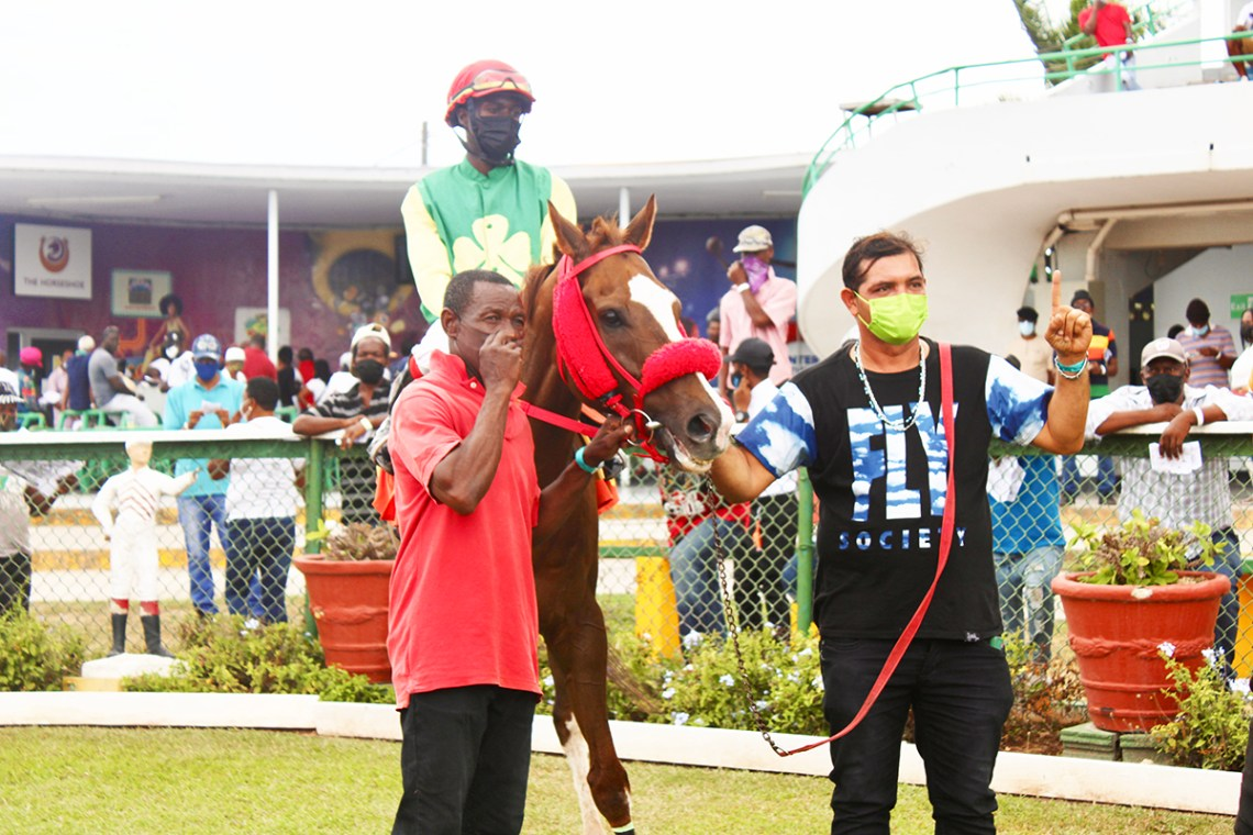 Trainer Chris Pearson (right) with his winning charge Secret Law. The jockey is Shavon Townsend and the listed groom is John Smith). (Photo: Kimberly Bartlett)