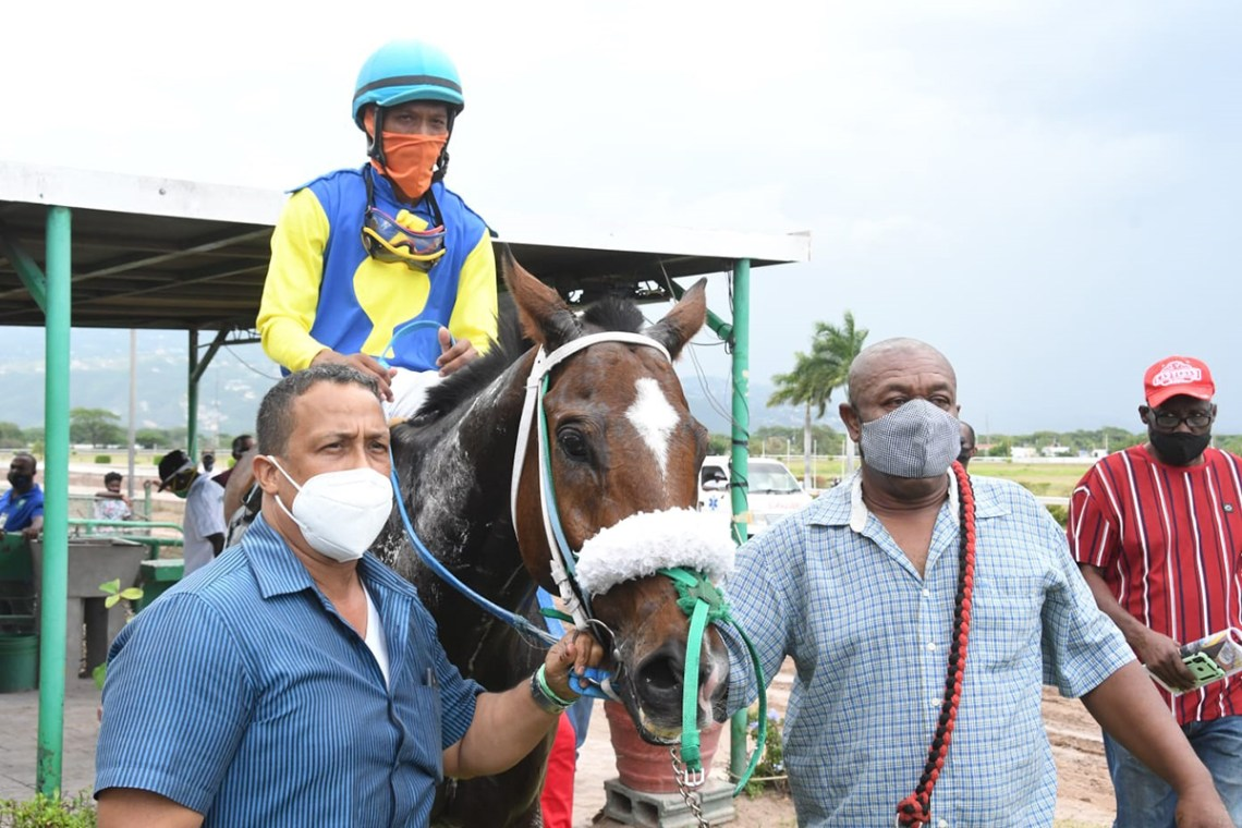 Trainer Gregory Forsyth (left) with his winner Cartel. The jockey is Anthony Thomas.