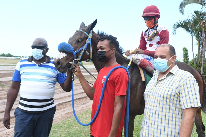 Jockey Anthony Thomas on his second winner for the day, My Time Now. Trainer Jason DaCosta is at right.