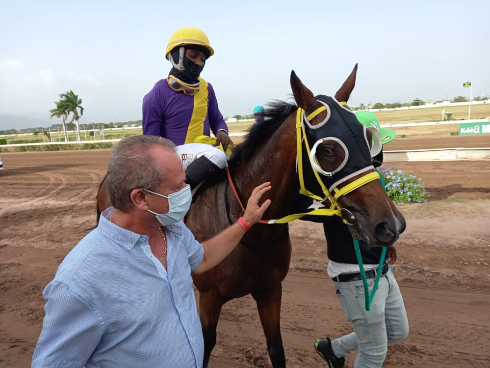 Trainer Gary Subratie leads in his winner Awesome Treasure with Dane Dawkins aboard.