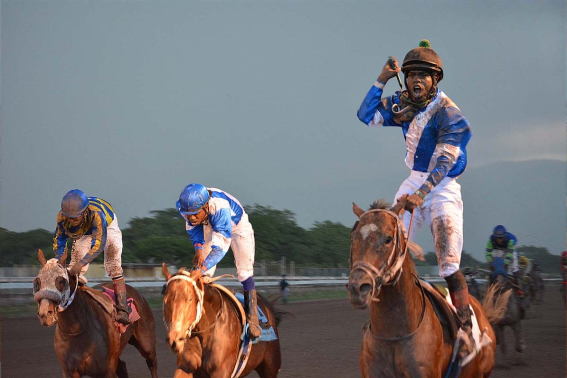 Jockey Linton Steadman (right) stands tall in the saddle atop Nipster in the 2020 Jamaica St Leger.