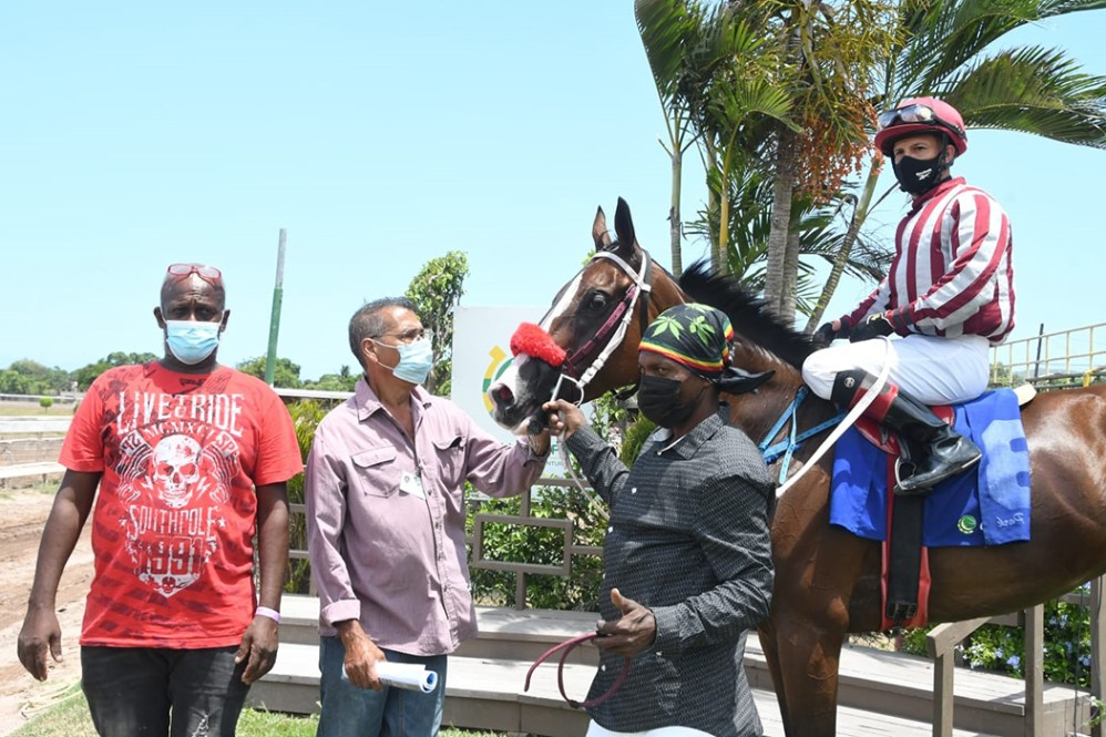 Trainer/owner of Stallwakin'Girl Errol Subratie (second left) with his winning charge with Dick Cardenas in the saddle.