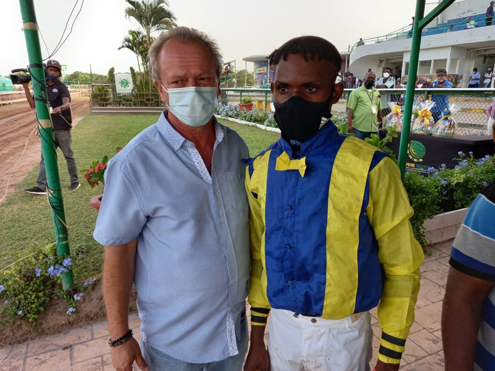 Trainer Gary Subratie (left) and jockey Tevin Foster.