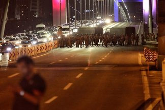"""ISTANBUL, TURKEY - JULY 15: Turkish soldiers block Istanbul's Bosphorus Brigde on July 15, 2016 in Istanbul, Turkey. Istanbul's bridges across the Bosphorus, the strait separating the European and Asian sides of the city, have been closed to traffic. Reports have suggested that a group within Turkey's military have attempted to overthrow the government. Security forces have been called in as Turkey's Prime Minister Binali Yildirim denounced an """"illegal action"""" by a military """"group"""", with bridges closed in Istanbul and aircraft flying low over the capital of Ankara. (Photo by Gokhan Tan/Getty Images)"""