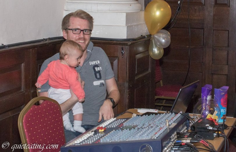 fiddling the sound while a young apprentice looked on