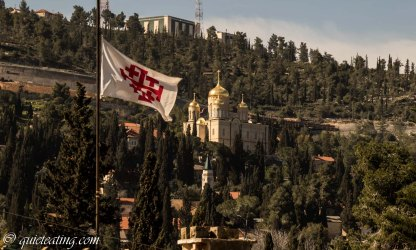 The Jerusalem cross flying with a Russian church in the distance