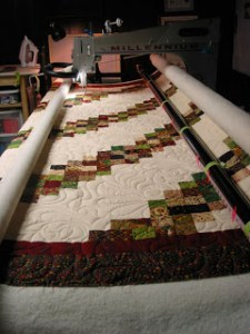 Moda jelly roll design quilt, quilted by Angela Huffman