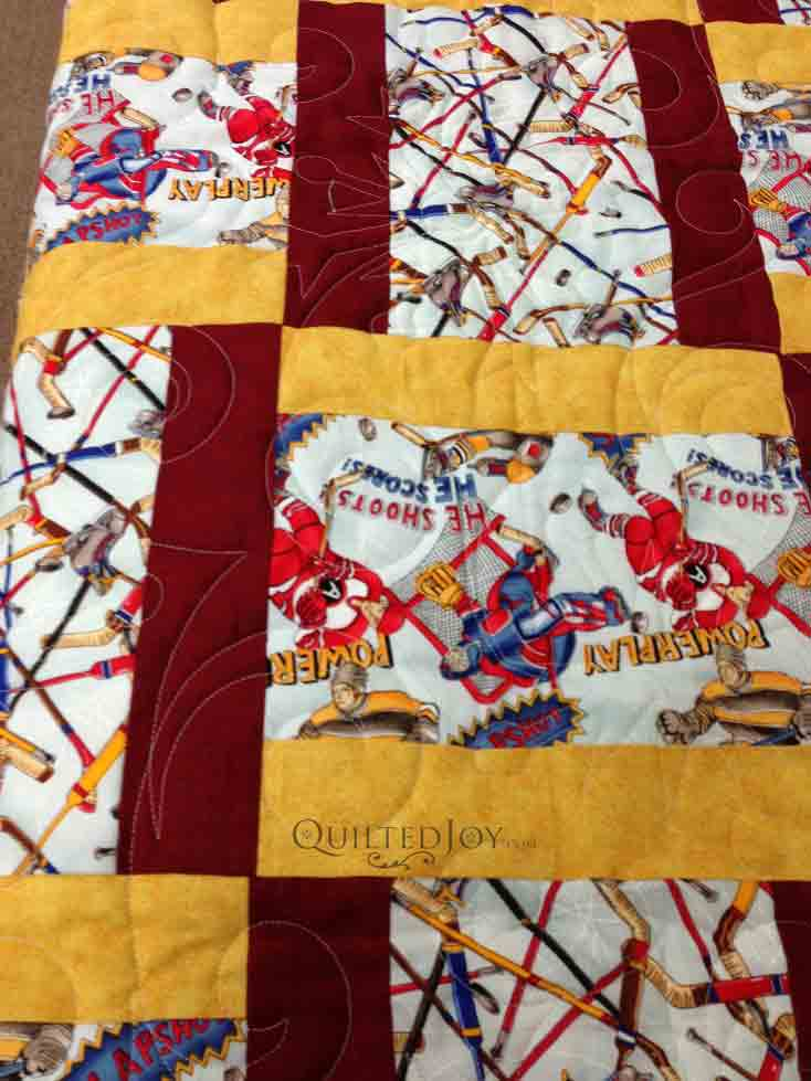 Modified Rail Fence Baby Quilt With Hockey Fabric
