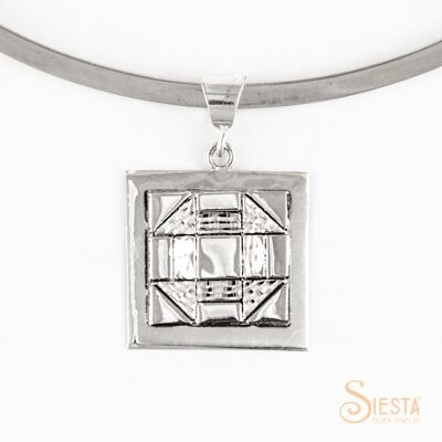 Medium Churn Dash sterling silver pendant by Siesta Silver Jewelry. Available at QuiltedJoy.com