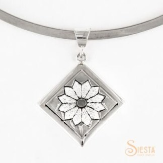 Medium dresden plate block sterling silver pendant by Siesta Silver Jewelry. Available at QuiltedJoy.com