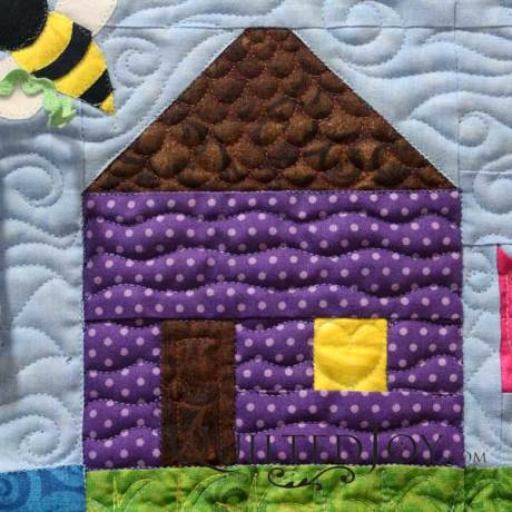 The second house on Quilted Joy's row is purple in remembrance to one of our favorite musicians, Prince