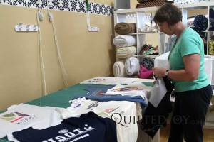 Barb tests different layouts for her T-shirt quilt