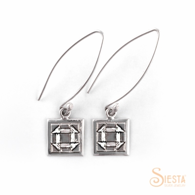 Churn Dash sterling silver earrings on a long wire from Siesta Silver Jewelry. Available at QuiltedJoy.com