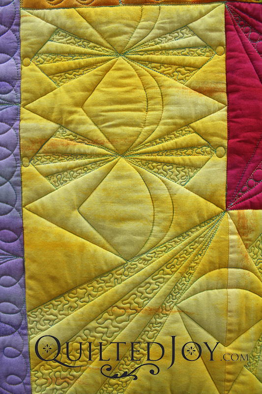 A high loft wool batting makes the quilt appear to pop up around the quilting lines.