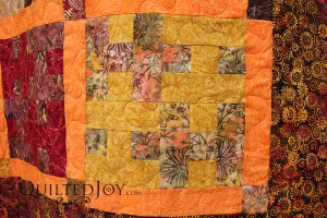 Susan's quilt is a tesselating design made entirely of batiks. I quilted it with a neutral thread that blends well and a meandering design. Fun!