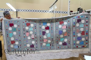 Colleen quilted 5 wintery table runners at the same time using the APQS Freddie at Quilted Joy