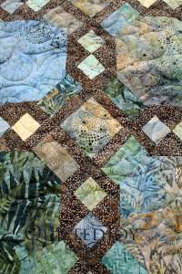 Snowball block variation quilt