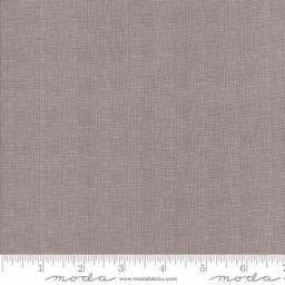 108″ Lulu Lane Slate, 11122 20, is 100% cotton fabric that is 108″ wide. The grey wide back fabric has a textured cross weave or crosshatching print. It's a fun and simple print that will complement a large variety of quilt tops!