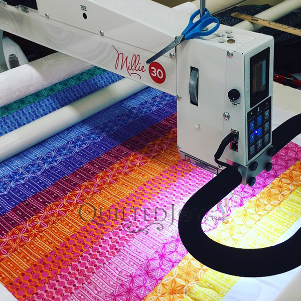 """APQS Millie 30 Longarm Quilting Machine has a 30"""" throat space and lots of room for quilting!"""