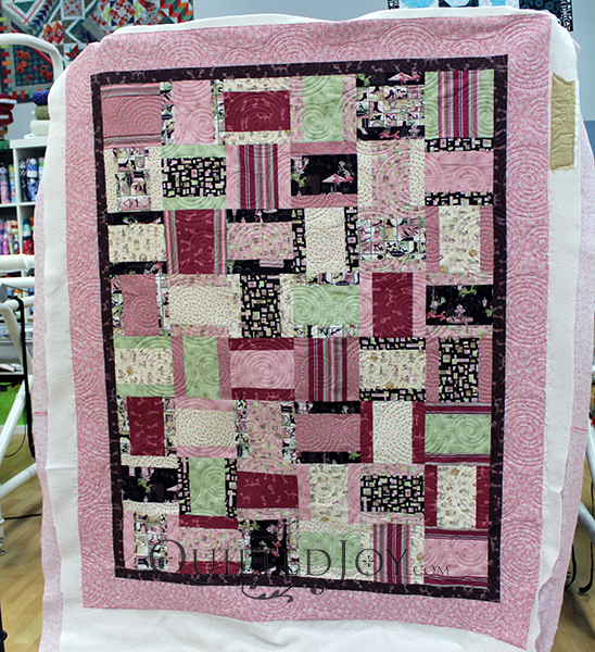 Lynn's Modified Rail Fence quilt with fun kitty fabrics