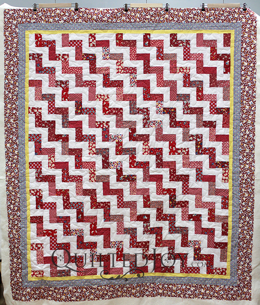 Split rail fence is a classic quilt pattern with many variations. The individual block consists of a set of stripes. The blocks are then arranged in a variety of ways to create different patterns.