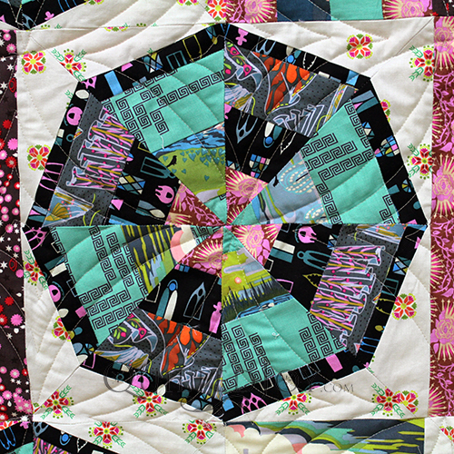 Linda made this playful Spider web quilt for her granddaughter and asked me to quilt it with an edge to edge design. We found the perfect design that carried that spiderweb quilt theme!