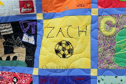 """Zach"" and a soccer ball hand embroidered on a quilt block"