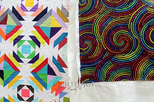 Valerie's Rainbow Pineapple Block Quilt and her Rainbow Dot Swirls Backing Fabric