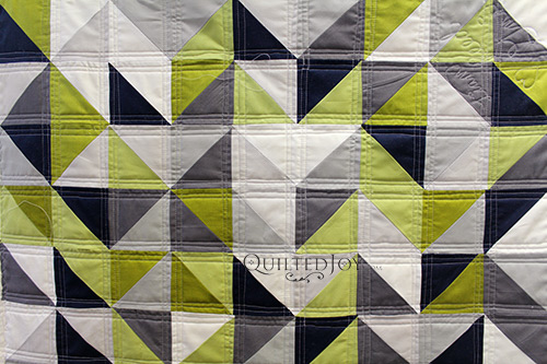 Gloria's Triangles Baby Quilt with straight line quilting quilted at Quilted Joy