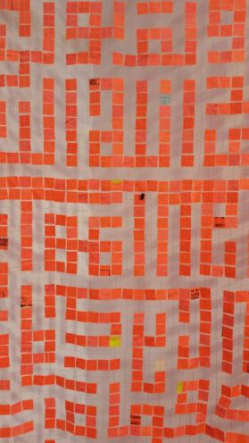 Geometric zinging orange patterns beautifully stitched between see though fabric-what's not to like?