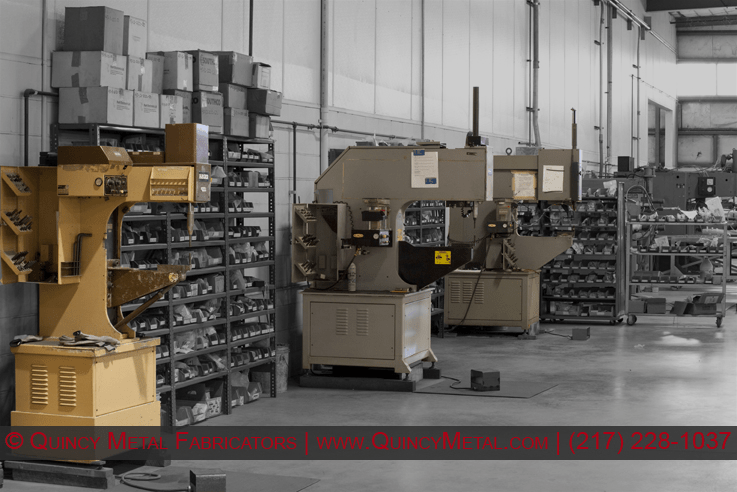 Three PEM hardware insertion machines in Quincy Metal Fabricators' hardware department