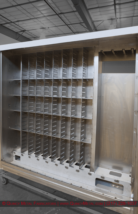 A large electrical enclosure cleaned, prepped, and ready for its first coat of paint