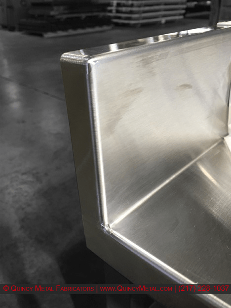 Superior stainless steel welding shown on a countertop piece, from Quincy Metal Fabricators' welding department