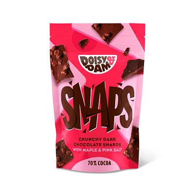Doisy and Dam Snaps. Chocolate negro colombiano de comercio justo. Un punto de sirope de arce. Arroz tostado crujiente y una pizca de sal rosa.