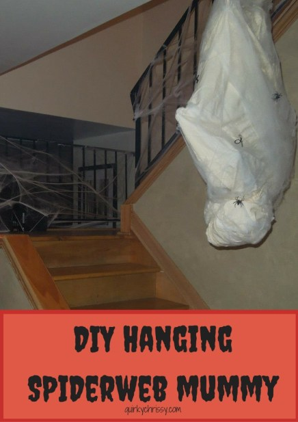 I made a homemade hanging mummy cocoon wrapped in spider webs and hung it from the banister in the stairwell for our Halloween Party