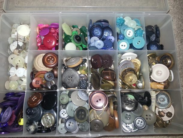 craft box full of buttons