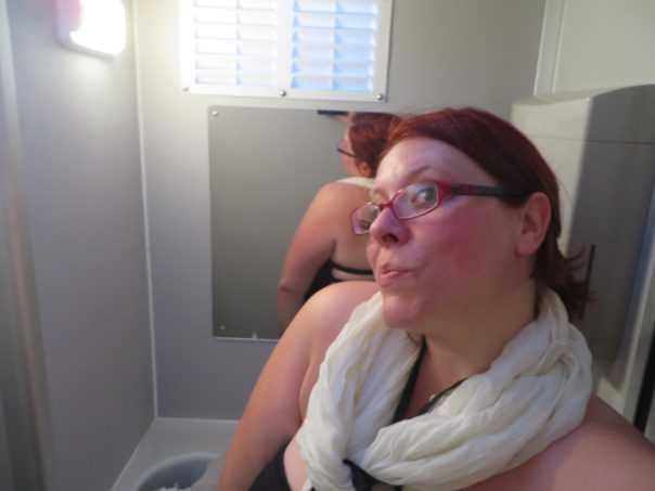 Fashion hack: use a scarf to hold a strapless dress up. ALSO, this may be the nicest port-o-potty ever.