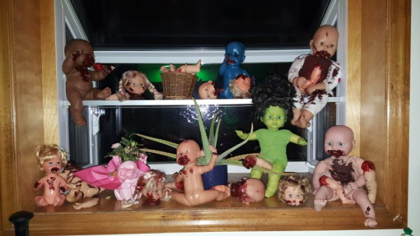 A scene of creepy cannibal baby dolls and bloody doll parts