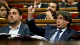 Catalonia's President Carles Puigdemont gestures during a confidence vote session at Catalan Parliament in Barcelona