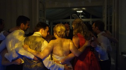 Wedding disco group hug on the dancefloor at The Carbis Bay Hotel, St Ives, Cornwall