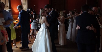 Couples first dance kiss witnessed by friends and family at Boconnoc Estate, Cornwall