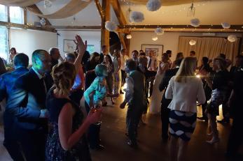 Looking down on the wedding disco dancefloor at the events barn at Nancarrow Farm, Cornwall