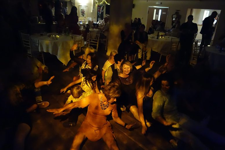 Classic dance moves on the floor at a wedding disco in Redruth, Cornwall
