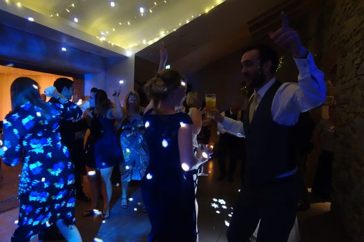 Dancing and drinking at a wedding evening party at Trevenna Barns, Cornwall