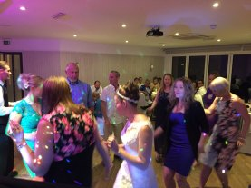 Bride Celebrating with her Guests on the Dancefloor at Watergate Bay Hotel, Newquay, Cornwall
