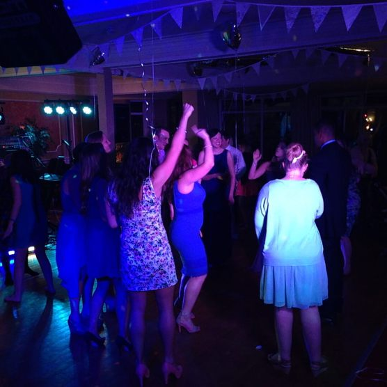 Mainly women on the dancefloor, a couple of them with arms in the air, 2014